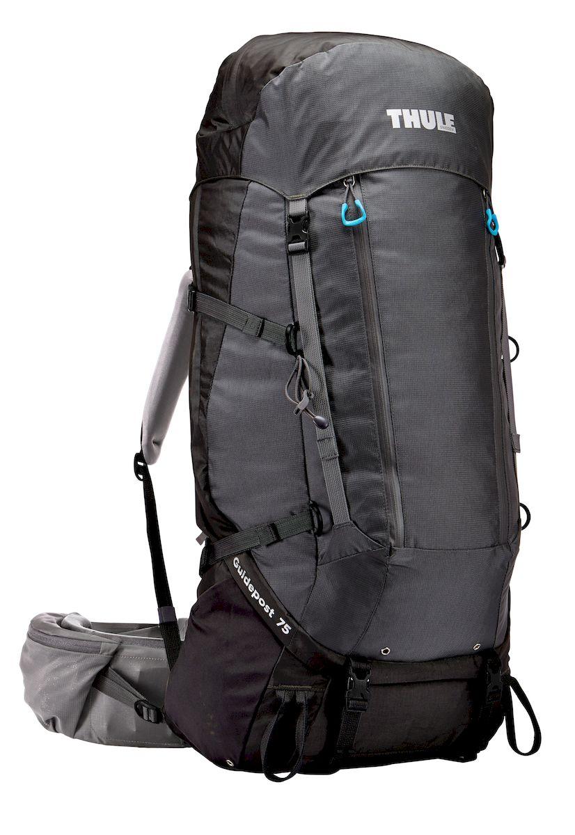 Рюкзак треккинговый мужской Thule Guidepost, цвет: черно-серый, 75л206200Мужской туристический рюкзак Thule Guidepost 75 л - Thule Guidepost 75 л идеально подходит для недельных походов. Рюкзак отличается настраиваемой системой крепления TransHub, обеспечивающей идеальную посадку, поворачивающимся набедренным ремнем, который позволяет рюкзаку повторять ваши движения, и крышкой, способной трансформироваться в дополнительный рюкзак, который поможет вам покорить любую вершину. Легкая регулировка ремней для торса на 15 см обеспечивает идеальную посадку, а наплечные ремни QuickFit позволяют выбрать из один из трех вариантов длины наплечных ремней Система крепления Transhub с алюминиевой опорой и проволочным каркасом из пружинной стали позволяют перенести вес рюкзака на бедра, обеспечивая более удобную переноску Поворачивающийся набедренный ремень позволяет рюкзаку повторять ваши движения, обеспечивая большую естественность передвижения и улучшенный баланс Съемная крышка трансформируется в просторный рюкзак 24 л, позволяя сочетать два рюкзака...