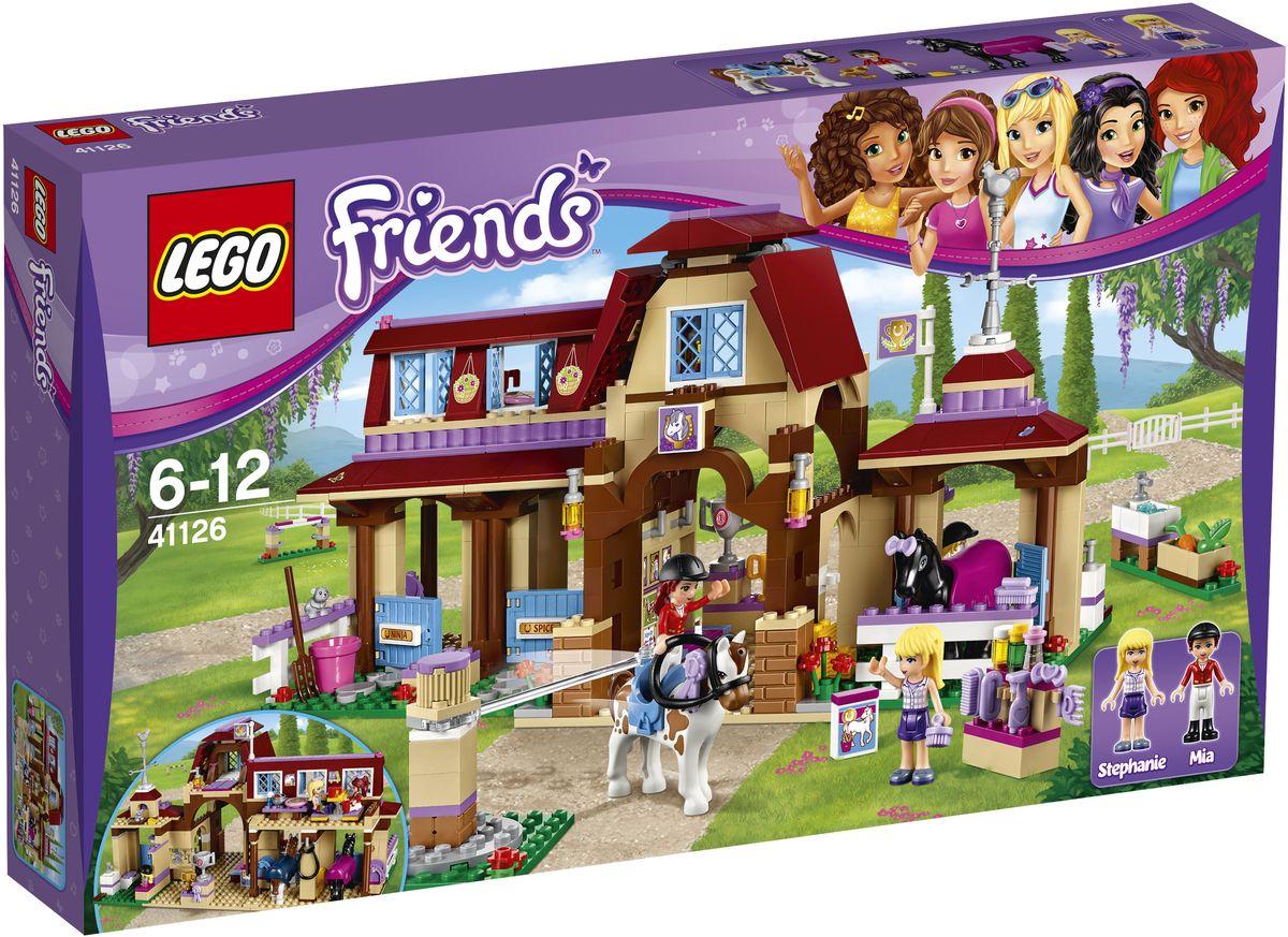 LEGO Friends Конструктор Клуб верховой езды 4112641126Используйте специальный тренажер, чтобы устроить разминку для пони, а потом потренируйте их в прыжках. Вы даже можете поднять планку. Ухаживать за лошадьми и переодеть их к соревнованиям можно в раздевалке. После соревнований поставьте лошадей в стойло, поболтайте с Мией и Стефани в кафетерии клуба верховой езды и отправляйтесь спать в мансарду. Завтра снова рано вставать! Набор включает в себя 575 разноцветных пластиковых элементов. Конструктор - это один из самых увлекательных и веселых способов времяпрепровождения. Ребенок сможет часами играть с конструктором, придумывая различные ситуации и истории.