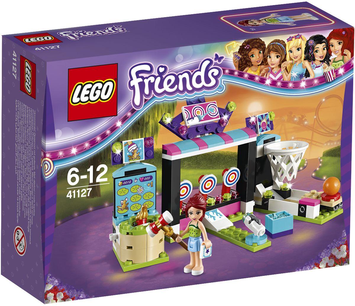 LEGO Friends Конструктор Парк развлечений Игровые автоматы 4112741127Мия играет в галерее игровых автоматов и отлично проводит время! Помогите ей попасть баскетбольным мячом в обруч, а когда у нее это получится, переходите к стрельбе из водяных пистолетов и попробуйте сбить мишени. А потом бейте лягушку молотком, чтобы попасть как можно больше раз. Мия собирается веселиться тут весь день. Набор включает в себя 174 разноцветных пластиковых элемента. Конструктор - это один из самых увлекательных и веселых способов времяпрепровождения. Ребенок сможет часами играть с конструктором, придумывая различные ситуации и истории.
