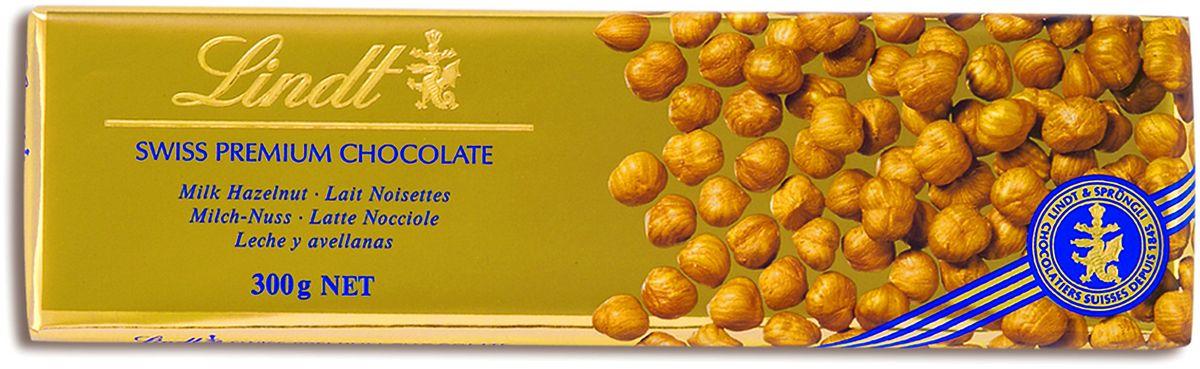 Lindt Gold молочный шоколад с цельным фундуком, 300 г7610400013864Шоколадная плитка большого формата Swiss premium из молочного шоколада с цельным фундуком создана по традиционному швейцарскому рецепту Мэтрами Шоколатье Lindt с 1845 года. Уважаемые клиенты! Обращаем ваше внимание, что полный перечень состава продукта представлен на дополнительном изображении.