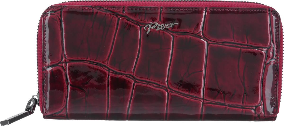 Портмоне женское Piero, цвет: рубиновый. 42М1_90093_21_П_2242М1_90093_21_П_22Стильное женское портмоне Piero изготовлено из натуральной лакированной кожи с тиснением под рептилию. Внутри находятся четыре отделения для купюр, одно отделение на молнии для мелочи, один прозрачный карман для визиток, два открытых кармана и восемь кармашков для визиток и карт. Портмоне закрывается на молнию. Портмоне упаковано в плотную коробку с логотипом фирмы. Такой функциональный аксессуар станет замечательным подарком человеку, ценящему качественные и практичные вещи.