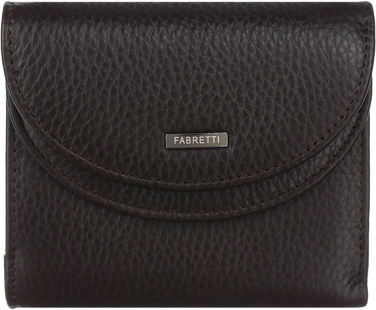 Кошелек мужской Fabretti, цвет: темно-коричневый. FA007-brownFA007-brownПрактичный и стильный мужской кошелек от Fabretti выполнен из натуральной мягкой кожи. Его лицевая сторона оформлена пластиной с логотипом бренда. В кошельке расположен объемный боковой карман для мелочи, который содержит два кармана для визиток и карт. Карман закрывается с помощью клапана с кнопкой. Внутри кошелька расположено два вместительных отделения для купюр. Изделие закрывается клапаном на кнопку. Кошелек упакован в плотную коробку с логотипом фирмы. Такой стильный и оригинальный аксессуар станет неотъемлемой частью вашего образа благодаря своей практичности.
