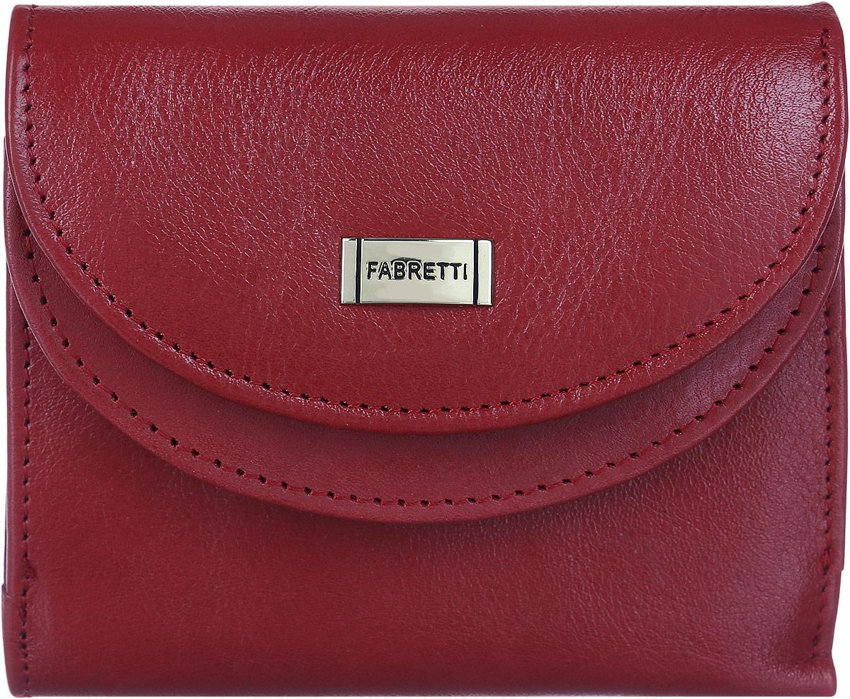Кошелек женский Fabretti, цвет: красный. FA007-redFA007-redСтильный женский кошелек от Fabretti выполнен из натуральной гладкой кожи. Аккуратная фурнитура делает дизайн утонченным и элегантным. На лицевой стороне расположен объемный карман для мелочи, который содержит два кармана для визиток и карт. Карман закрывается с помощью клапана с кнопкой. Внутри расположены два вместительных отделения для купюр. Изделие закрывается клапаном на кнопку. Кошелек упакован в плотную коробку с логотипом фирмы. Такой элегантный и оригинальный аксессуар станет неотъемлемой частью вашего образа благодаря своей практичности.