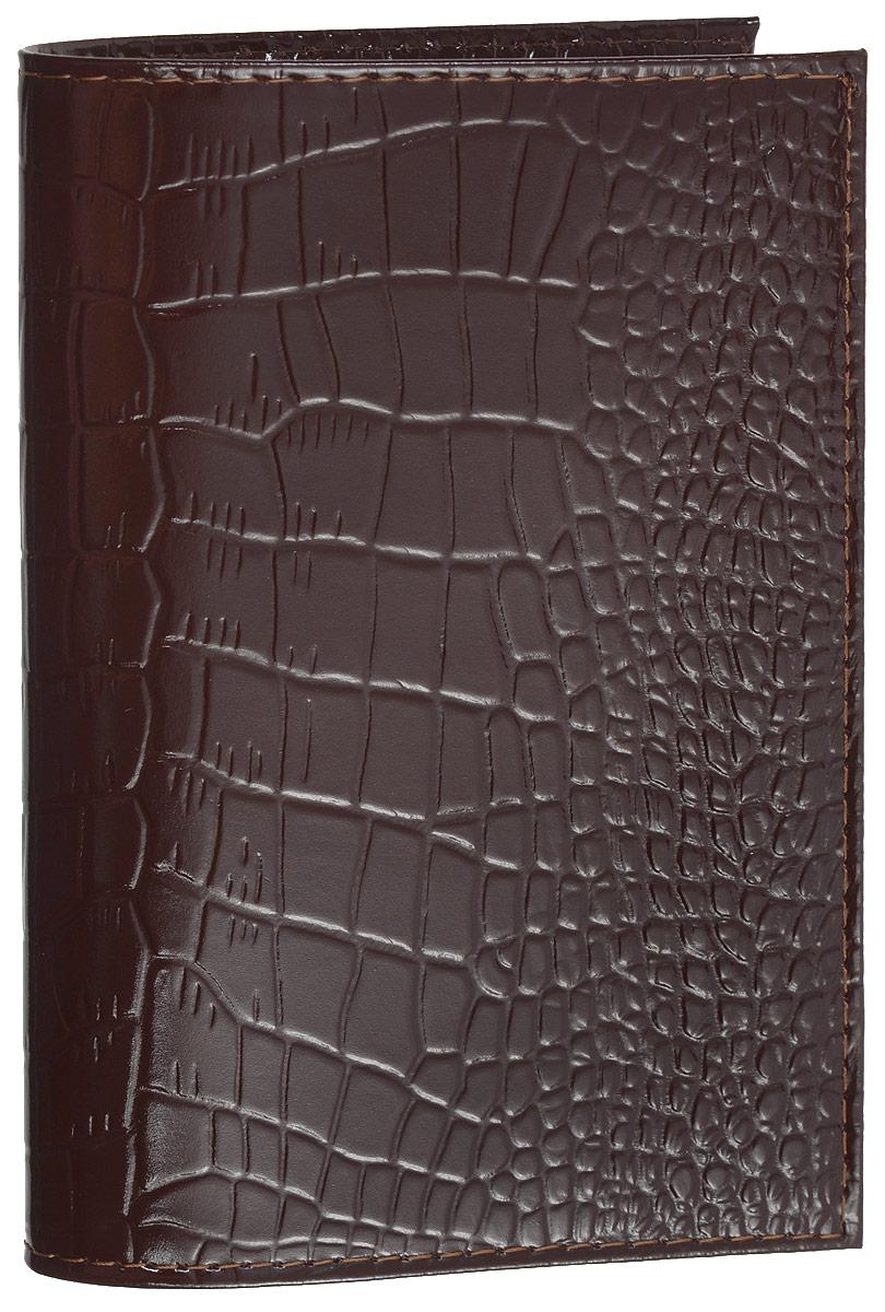 Обложка для паспорта Mitya Veselkov, цвет: темно-коричневый. SPEKTRF-BORDOSPEKTRF-BORDOОригинальная обложка для паспорта Mitya Veselkov изготовлена из натуральной кожи с тиснением под рептилию. Изделие раскрывается пополам. Документ надежно фиксируется внутри при помощи двух прозрачных клапанов, расположенных на внутреннем развороте обложки. Изделие дополнено двумя внутренними прорезными карманами для кредиток и карт. Обложка не только поможет сохранить внешний вид документов, но и станет стильным аксессуаром, который подчеркнет ваш образ. Обложка для паспорта может стать отличным подарком.
