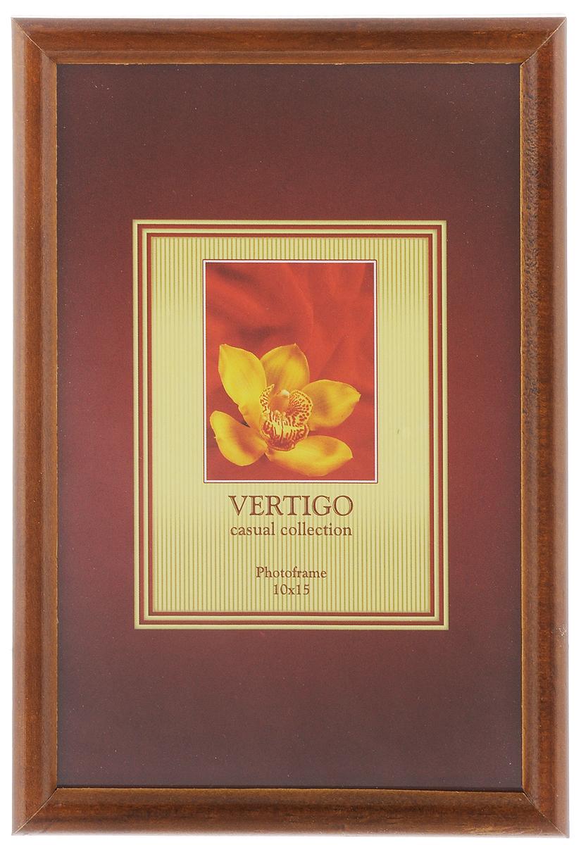 Фоторамка Vertigo Veneto, цвет: темно-коричневый, 10 х 15 см12179 WF-019/179_темно-коричневыйФоторамка Vertigo Veneto выполнена из дерева и стекла, защищающего фотографию. Оборотная сторона рамки оснащена специальной ножкой, благодаря которой ее можно поставить в любое удобное место в доме или офисе. Также изделие оснащено специальными металлическими петлями для подвешивания на стену. Такая фоторамка поможет вам оригинально и стильно дополнить интерьер помещения, а также позволит сохранить память о дорогих вам людях и интересных событиях вашей жизни.
