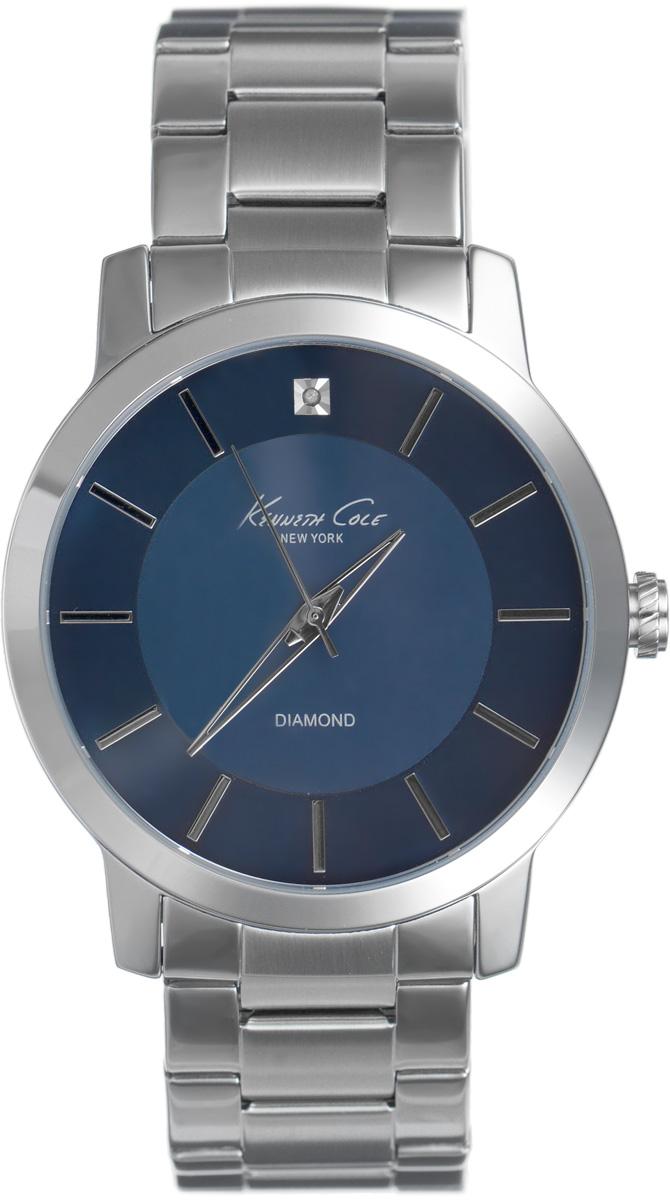 Часы наручные мужские Kenneth Cole, цвет: серебристый. IKC9329IKC9329Стильные мужские часы Kenneth Cole выполнены из латуни, нержавеющей стали и минерального стекла. Циферблат изделия дополнен символикой бренда и украшен бриллиантовой вставкой. Часы оснащены кварцевым механизмом с тремя стрелками, полированным корпусом, устойчивым к царапинам минеральным стеклом, степенью влагозащиты 5atm. Изделие дополнено ремешком из нержавеющей стали, оснащенным удобной раскладывающейся застежкой, позволяющей максимально комфортно и быстро снимать и одевать часы. Часы поставляются в фирменной упаковке. Часы Kenneth Cole подчеркнут мужской характер и отменное чувство стиля их обладателя.