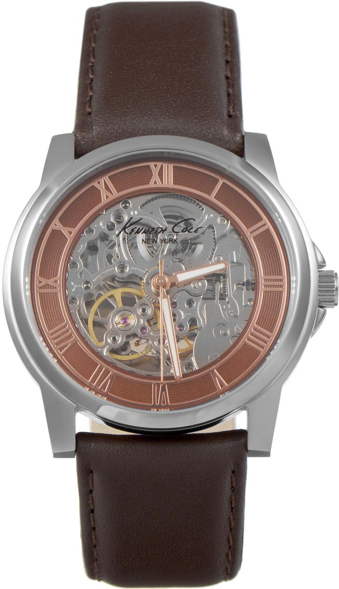 Часы наручные мужские Kenneth Cole, цвет: коричневый. IKC1745IKC1745Мужские механические скелетонизированные часы Kenneth Cole изготовлены из материалов самого высокого качества на базе новейших технологий. Циферблат оформлен символикой бренда. Корпус часов имеет степень влагозащиты, равную 3 Bar, оснащен механическим механизмом, а также устойчивым к царапинам минеральным стеклом. Задняя крышка дополнена стеклянной вставкой, благодаря чему видно элементы механизма. Ремешок, выполненный из натуральной кожи, застегивается на практичную пряжку. Часы поставляются в фирменной упаковке. Часы Kenneth Cole подчеркнут отменное чувство стиля их обладателя.