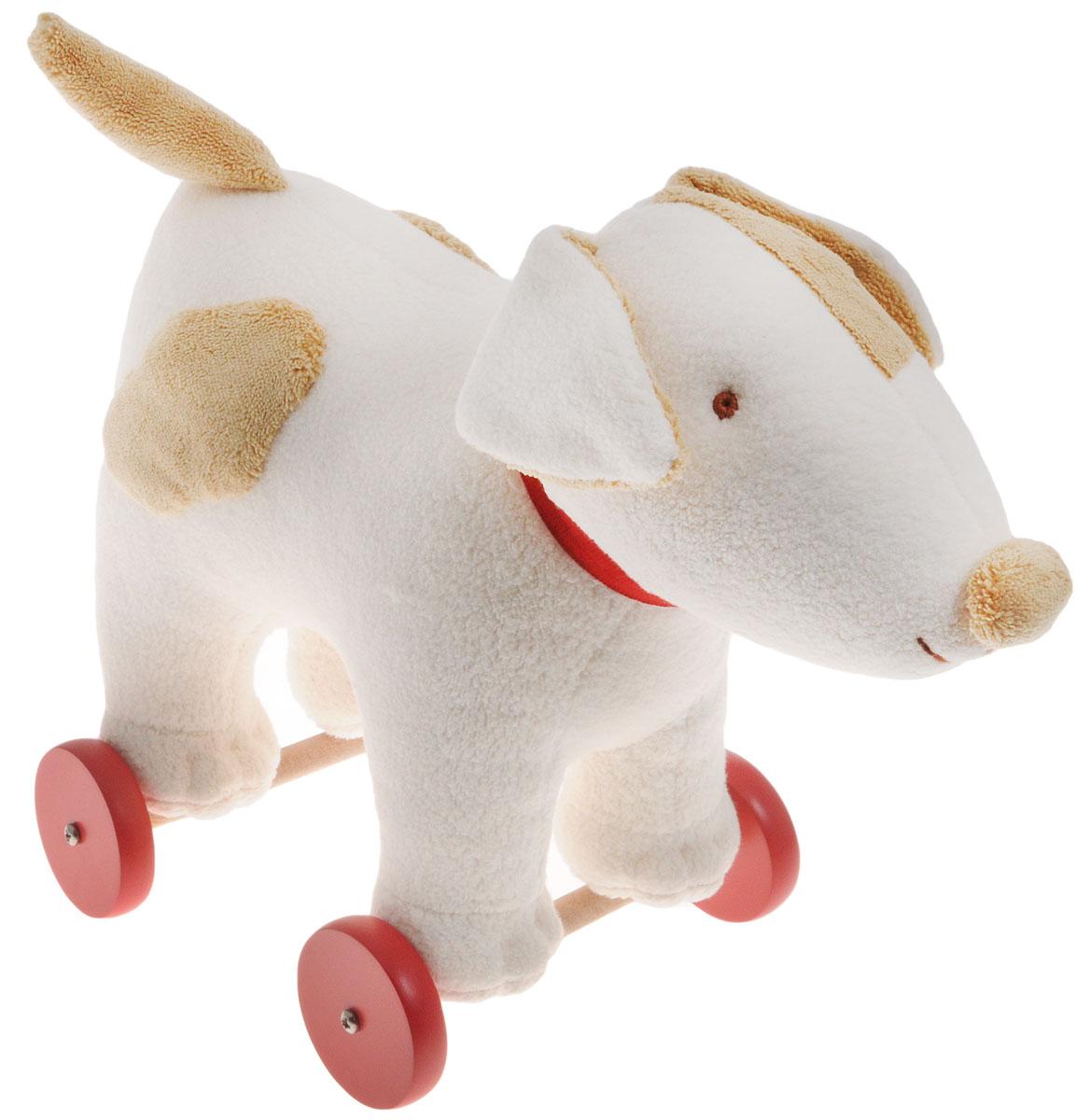 Trousselier Игрушка-каталка СобакаV4001 42Игрушка-каталка Trousselier Собака никого не оставит равнодушным и обязательно вызовет улыбку у всех, кто ее увидит. Изделие изготовлено из приятных на ощупь и мягких материалов. Игрушка выполнена в виде милой собачки с красным ошейником, стоящей на деревянных колесиках. Игрушка- каталка Trousselier Собака станет отличным подарком для ребенка! Такая игрушка будет подталкивать ребенка больше ходить, развивает мелкую моторику и координацию движений.