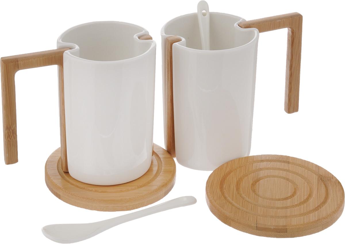 Набор чайный EcoWoo, 6 предметов2012242UНабор чайный EcoWoo - это не только идеальный подарок, но и прекрасный повод побаловать себя! Набор состоит из 2 фарфоровых кружек со съемными ручками, 2 бамбуковых подставок и 2 ложек. Такой набор станет идеальным решением для ценителей экологичных деталей в интерьере и поклонников здорового образа жизни. Не использовать в посудомоечной машине. Объем кружки: 280 мл. Диаметр кружки (по верхнему краю): 7,5 см. Высота кружки: 10 см. Диаметр подставки: 10 см. Длина ложки: 13 см.