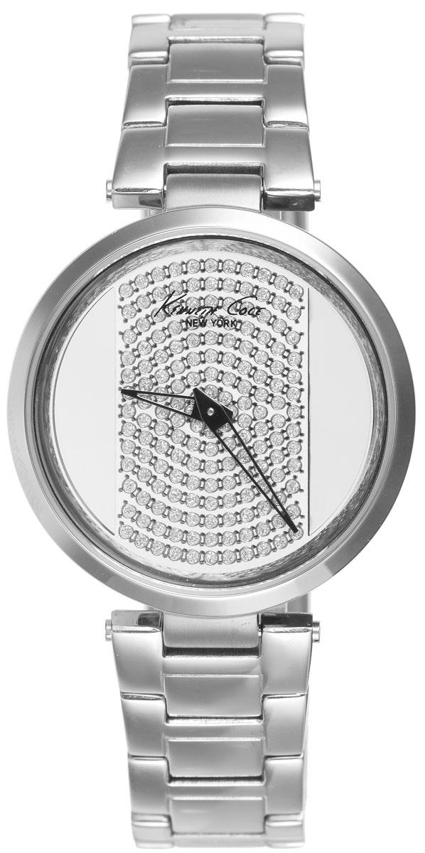 Часы наручные женские Kenneth Cole, цвет: серебристый. IKC0035IKC0035Стильные женские часы Kenneth Cole выполнены из нержавеющей стали и минерального стекла. Циферблат изделия дополнен символикой бренда и инкрустирован стразами. Часы оснащены кварцевым механизмом с двумя стрелками, прозрачным корпусом, устойчивым к царапинам минеральным стеклом, степенью влагозащиты 3atm. Изделие дополнено ремешком из нержавеющей стали, оснащенным удобной раскладывающейся застежкой, позволяющей максимально комфортно и быстро снимать и одевать часы. Часы поставляются в фирменной упаковке. Часы Kenneth Cole - аксессуар, о котором можно только мечтать. Блистательный циферблат легко подчинит себе ваше время.