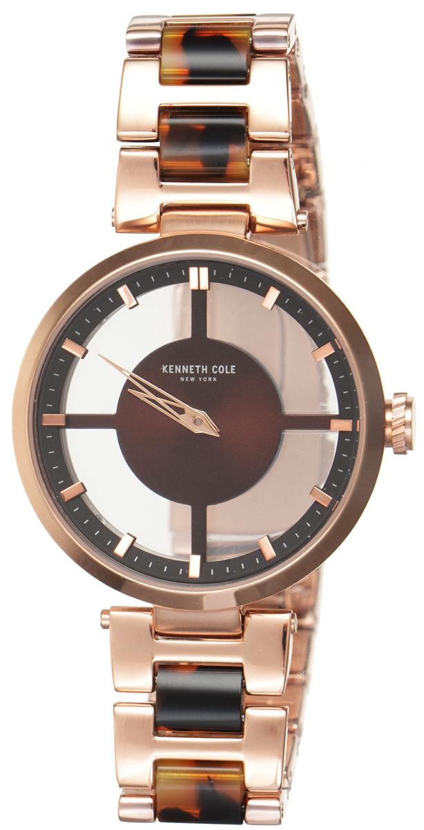 Часы наручные женские Kenneth Cole, цвет: золотой, коричневый. IKC4766IKC4766Стильные женские часы Kenneth Cole выполнены из нержавеющей стали с PVD-покрытием и минерального стекла. Минималистичный циферблат изделия дополнен символикой бренда. Часы оснащены кварцевым механизмом с двумя стрелками, прозрачным корпусом, устойчивым к царапинам минеральным стеклом, степенью влагозащиты 3atm. Изделие дополнено ремешком из нержавеющей стали с PVD-покрытием, оснащенным удобной раскладывающейся застежкой, позволяющей максимально комфортно и быстро снимать и надевать часы. Часы поставляются в фирменной упаковке. Аксессуары Kenneth Cole очень стильные, но при этом весьма практичные. Их можно носить в любое время и в любой ситуации. Подход марки Kenneth Cole утилитарен, формы лаконичны, детали неожиданны.