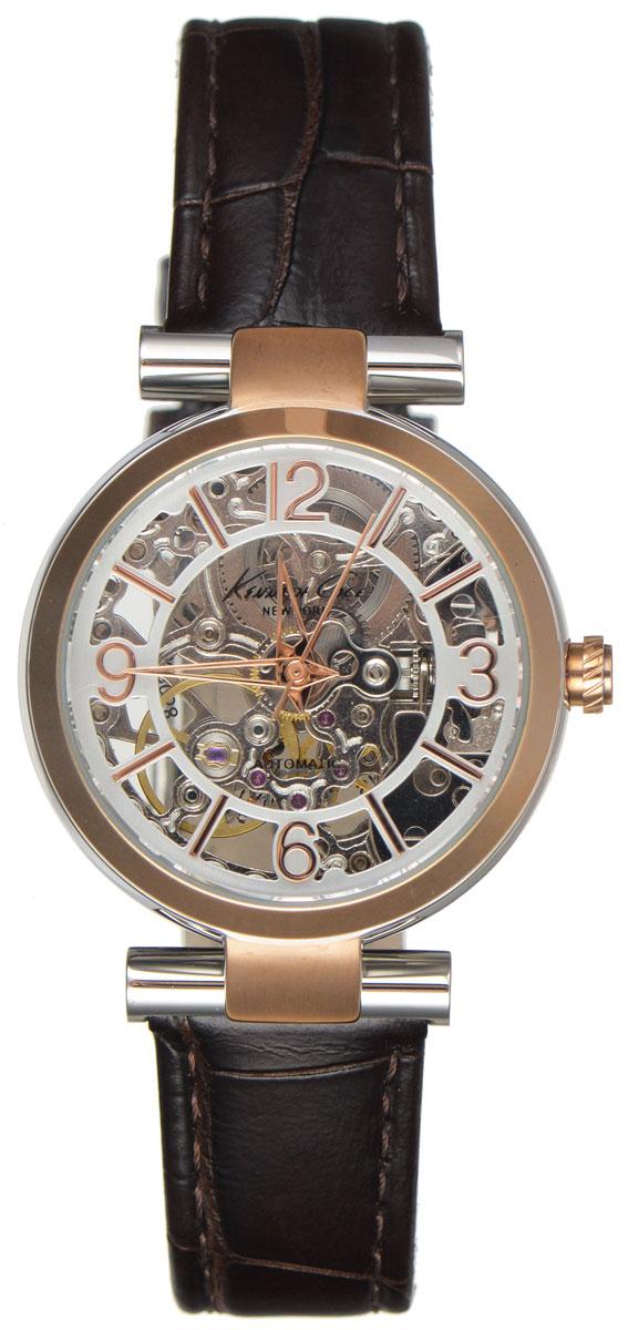 Часы наручные женские Kenneth Cole, цвет: коричневый. IKC2819IKC2819Женские механические скелетонизированные часы Kenneth Cole изготовлены из материалов самого высокого качества на базе новейших технологий. Циферблат оформлен символикой бренда. Корпус часов изготовлен из нержавеющей стали с PVD-покрытием и имеет степень влагозащиты, равную 5 Bar, оснащен механическим механизмом, а также устойчивым к царапинам минеральным стеклом. Задняя крышка дополнена стеклянной вставкой, благодаря чему видно элементы механизма. Ремешок, выполненный из натуральной кожи с тиснением под крокодила, оснащен классической застежкой. Часы поставляются в фирменной упаковке. Часы Kenneth Cole для любителей оригинальных, неординарных аксессуаров, подчеркнут отменное чувство стиля их обладателя.