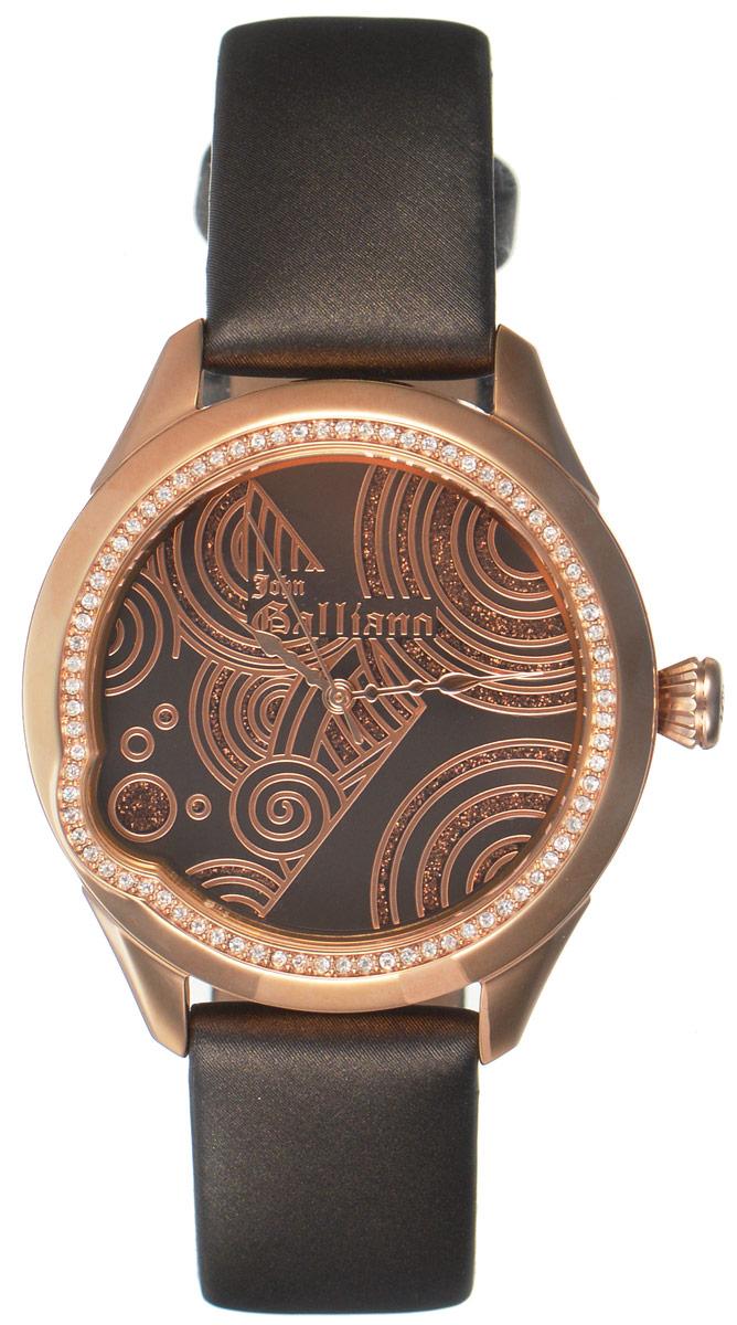 Часы наручные женские Galliano, цвет: коричневый. R2551130501R2551130501Наручные женские часы Galliano произведены из материалов самого высокого качества на базе новейших технологий. Они оснащены точным кварцевым механизмом. Корпус часов изготовлен из нержавеющей стали с PVD-покрытием и инкрустирован стразами, циферблат защищен минеральным стеклом. Ремешок выполнен из натуральной кожи и оснащен классической застежкой-пряжкой. Циферблат круглой формы оснащен тремя стрелками - часовой, минутной и секундной. Часы являются водостойкими - 3АТМ. Изделие укомплектовано в стильную фирменную коробку с названием бренда. Наручные часы Galliano созданы для современных девушек, которые не желают потерять свою индивидуальность в городской суете.