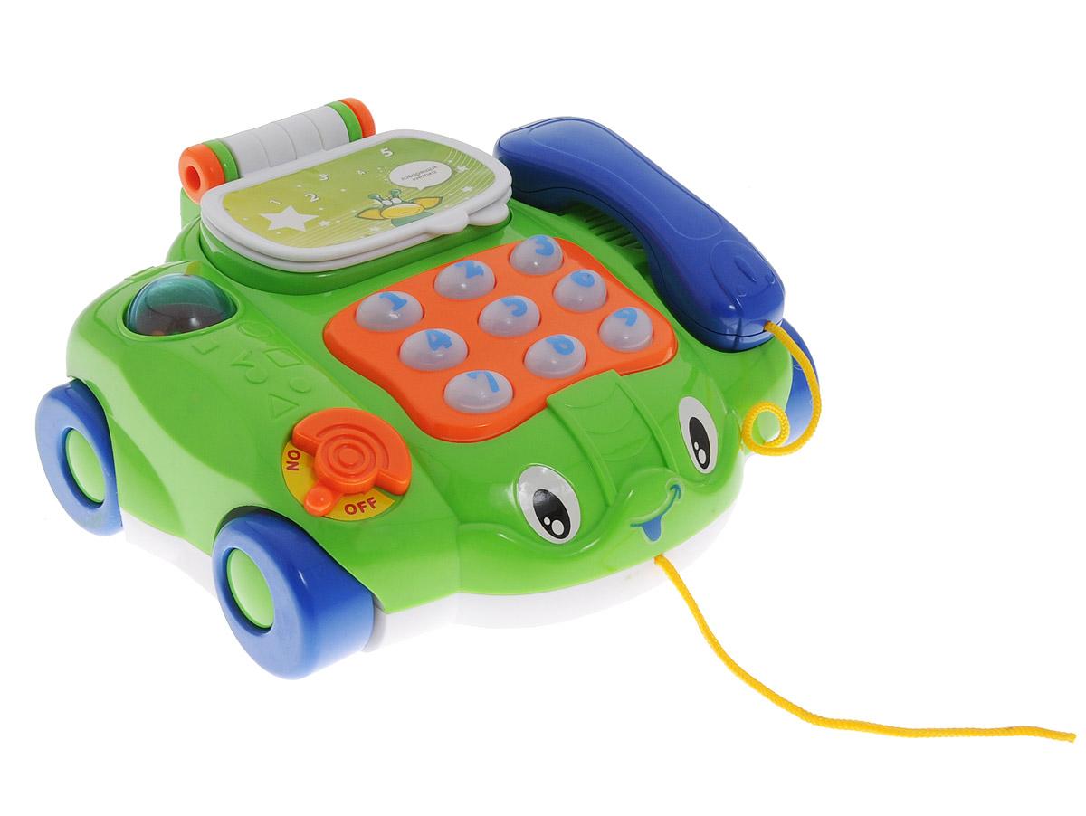 Joy Toy Игрушка-каталка Телефончик на колесах цвет зеленыйA236-H28003Игрушка-каталка Joy Toy Телефончик на колесах надолго привлечет внимание малыша. Яркая игрушка со световыми и звуковыми эффектами выполнена в виде телефона с различными функциями. Телефончик на колесах можно катать за веревочку, что будет стимулировать малыша ходить и окажет положительное влияние на развитие координации. Игрушка помогает малышам освоить счет и цифры. При нажатии на кнопку с цифрой - она подсвечивается, телефончик озвучивает цифру и проигрывает мелодию. Порадуйте вашего ребенка таким замечательным подарком! Рекомендуется докупить 2 батарейки напряжением 1,5V типа АА (товар комплектуется демонстрационными).