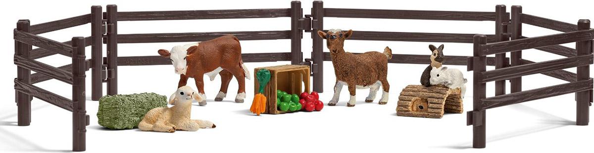 Schleich Набор фигурок Детский зоопарк 4 шт21052Набор фигурок Schleich Детский зоопарк поможет сделать игру еще более увлекательной, а жизнь в игрушечной ферме полноценной и удобной. В этом превосходном наборе ребенок найдет несколько реалистичных фигурок животных фермы, с которыми он сможет придумать множество интересных игр. В набор входят детали для сборки изгороди, теленок, ягненок, козленок, фигурка с двумя кроликами, сено, ящик с яблоками и морковью. Все игрушки из набора выполнены из качественного каучукового пластика с мельчайшей прорисовкой деталей. Игровые элементы имеют реалистичный внешний вид, приятны на ощупь и позволяют детям играть с большим удовольствия.