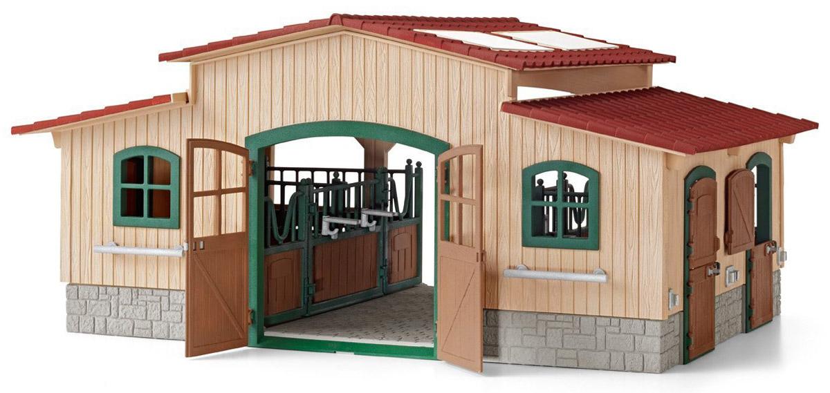 Schleich Конюшня42110Красочная конюшня Schleich, выполненная в соответствии с необходимыми требованиями для содержания домашних животных, станет прекрасным подарком для всех поклонников игрушечных лошадей. Просторная и реалистичная конюшня поможет разнообразить игру детей и вместит всех любимых питомцев. Конюшня имеет несколько отсеков для размещения лошадей, двери и окна в помещении открываются. Можно модернизировать конюшню по своему усмотрению, чтобы всем лошадкам было удобно и интересно жить на современной ферме. На крыше конюшни прозрачные окна, которые открываются, чтобы внутрь проникал свет и свежий воздух.