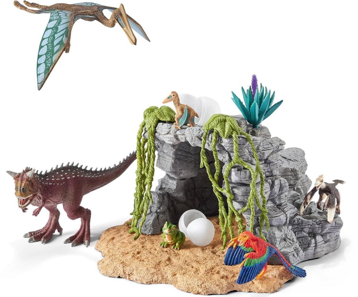 Schleich Игровой набор Пещера динозавров42261Игровой набор Schleich Пещера динозавров произведет впечатление на каждого ребенка и увлекающегося коллекционера. Красочные фигурки имеют реальное сходство с вымершими животными, приятны на ощупь и безопасны для игр детей. Динозавры выполнены из качественного каучукового пластика, который безопасен для детей. Каждая игрушка выполнена с особенной тщательностью и вниманием к деталям. Игрушки раскрашиваются вручную, имеют оригинальную текстуру. В набор входят 6 фигурок динозавров, пещера, тропические растения. Набор станет прекрасным подарком для всех поклонников динозавров, с которым будет интересно устраивать увлекательные игры и наслаждаться красочными фигурками доисторических животных.