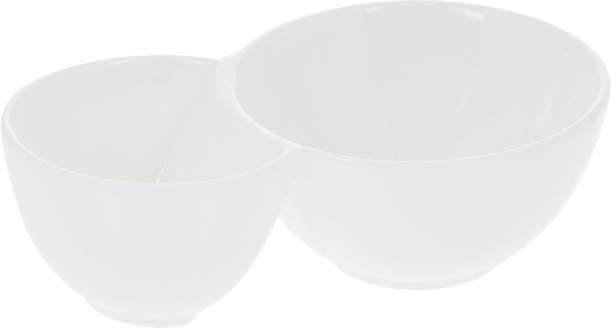 Емкость для закусок Wilmax, 15 х 9 х 4,5 смWL-992571 / AЕмкость для закусок Wilmax, изготовленная из высококачественного фарфора, состоит из двух секций. Большая секция предназначена для закусок, а маленькая - для соусов к ним. Такая емкость станет украшением как праздничного, так и повседневного обеденного стола. Она функциональная, практичная в использовании и легкая в уходе. Диаметр секций: 9 см; 7 см. Общий размер емкости: 15 х 9 х 4,5 см.