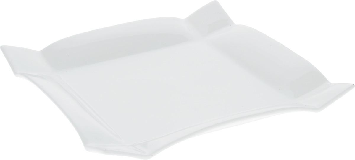 Тарелка Wilmax, 25 х 25 смWL-991232 / AТарелка Wilmax, изготовленная из высококачественного фарфора, имеет квадратную форму. Оригинальный дизайн придется по вкусу и ценителям классики, и тем, кто предпочитает утонченность и изысканность. Тарелка Wilmax идеально подойдет для сервировки стола и станет отличным подарком к любому празднику. Размер тарелки (по верхнему краю): 25 х 25 см.