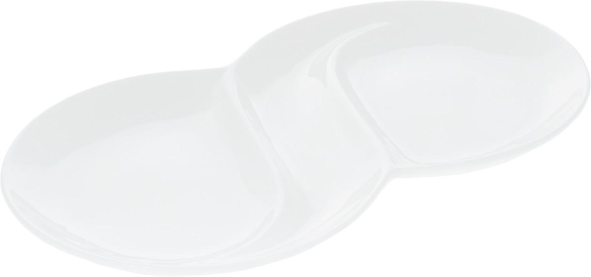 Менажница Wilmax, 2 секцииWL-992488 / AМенажница Wilmax, изготовленная из высококачественного фарфора, состоит из 2 секций, выполненных в виде блюд. Изделие предназначено для подачи сразу нескольких видов закусок, нарезок, соусов и варенья. Оригинальная менажница Wilmax станет настоящим украшением праздничного стола и подчеркнет ваш изысканный вкус. Размер менажницы: 31,8 х 18 х 2,5 см. Диаметр секций: 18 см.