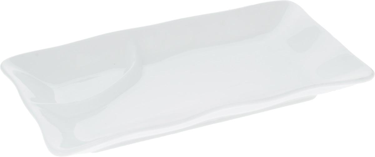Блюдо Wilmax, 25 х 14 смWL-992590 / AОригинальное прямоугольное блюдо Wilmax изготовлено из высококачественного фарфора. Изделие, оснащенное углублением для различных соусов, прекрасно подойдет для подачи нарезок, закусок и других блюд. Оно украсит ваш кухонный стол, а также станет замечательным подарком к любому празднику. Размер блюда (по верхнему краю): 25 х 14 см.