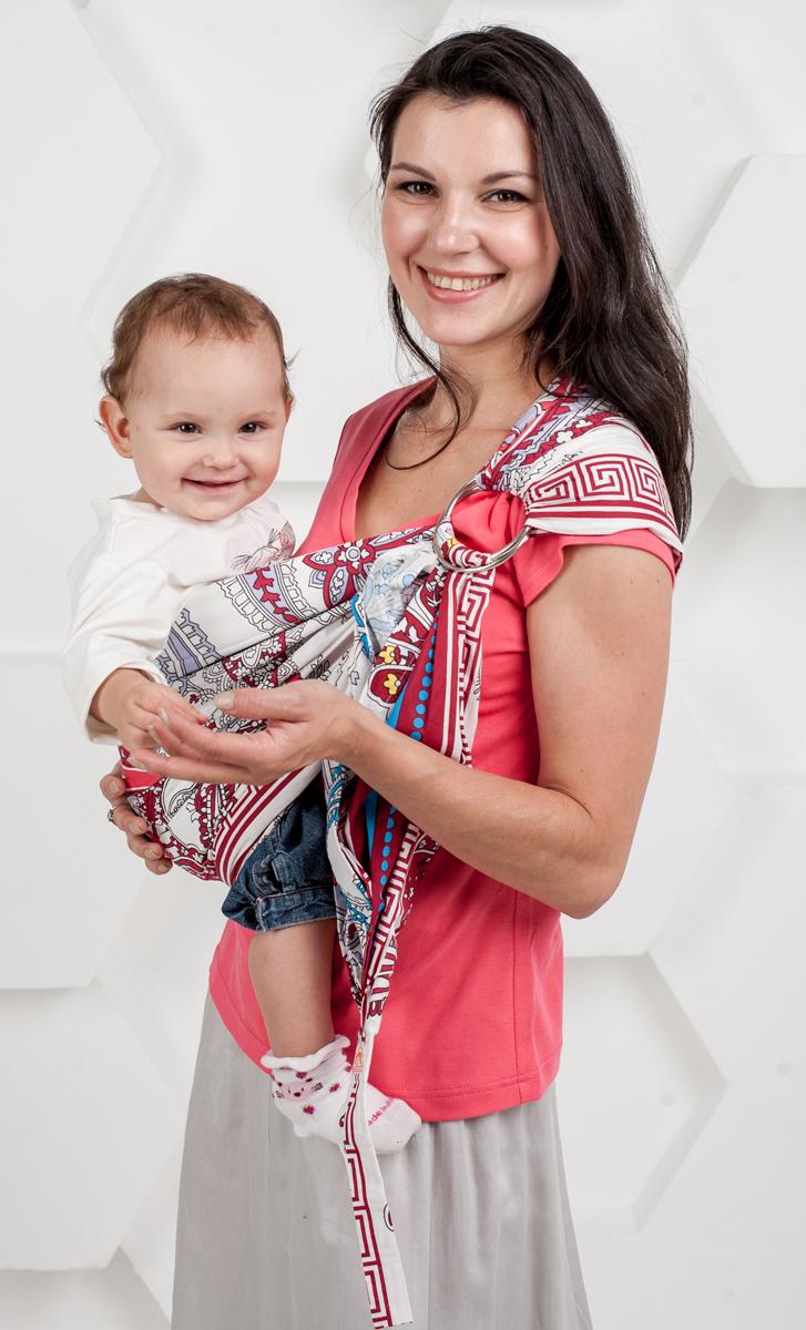 Мамарада Слинг с кольцами Леона размер М6360Слинг с кольцами позволяет носить ребенка как горизонтально в положении Колыбелька так и в вертикальном положении. В слинге в положении Колыбелька малыш располагается точно так же, как у мамы на руках, что особенно актуально для новорожденного. Ткань слинга равномерно поддерживает спинку малыша по всей длине. Малышу комфортно и спокойно рядом с мамой. Мама в это время может заняться полезными делами или прогуляться. В положении Колыбелька очень удобно кормить ребенка грудью. В слинге в вертикальном положении ножки ребенка разводятся лягушкой. Это положение снимает нагрузку с копчика — ребенок поддерживается нижним бортиком слинга под коленками, а верхним прижимается к маминой груди. Положение ребенка в слинге лягушкой – прекрасная профилактика дисплазии. Слинг из Пакистанской бязи (хлопок 100%) При изготовлении этого вида ткани используются очень тонкие нити, но плотно переплетенные, за счет чего ткань становится тонкой, но очень прочной, гладкой и мягкой. Очень...