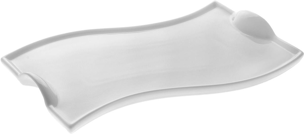 Блюдо Wilmax, 26 х 15,5 смWL-992576 / AОригинальное блюдо Wilmax, изготовленное из фарфора с глазурованным покрытием, оснащено ручками для удобной переноски. Изделие прекрасно подойдет для подачи нарезок, закусок и других блюд. Оно украсит ваш кухонный стол, а также станет замечательным подарком к любому празднику. Размер блюда: 26 х 15,5 см. Высота стенки: 1,5 см.