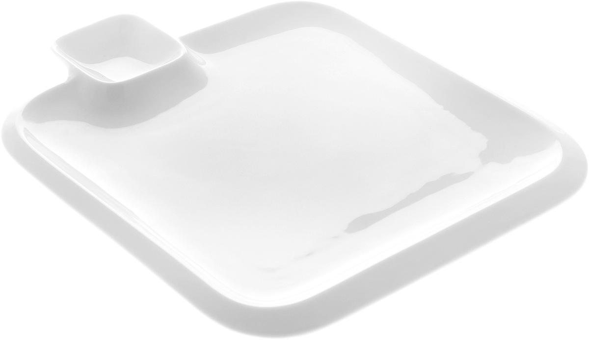 Блюдо квадратное Wilmax, с соусником, 26 х 26 х 1,5 смWL-992654 / AБлюдо Wilmax выполнено из высококачественного фарфора с глазурованным покрытием. Внутри блюда находится соусник. Блюдо Wilmax идеально подойдет для сервировки стола и станет отличным подарком к любому празднику. Размер блюда по верхнему краю: 26 х 26 х 1,5 см. Размер соусника: 6,5 х 6,5 см.