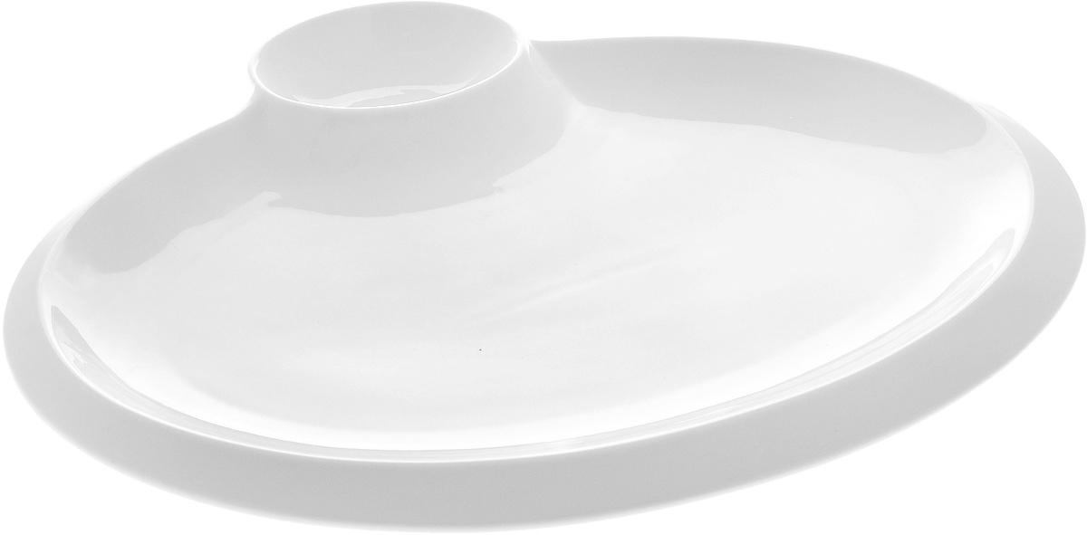 Блюдо Wilmax, 40 х 31,5 смWL-992632 / AОригинальное блюдо Wilmax, выполненное из высококачественного фарфора, имеет овальную форму и оснащено соусником. Изделие идеально подойдет для сервировки праздничного или обеденного стола, а также станет отличным подарком к любому празднику. Размер блюда (по верхнему краю): 37 х 24,5 см. Высота стенки блюда: 2 см. Размер соусника (по верхнему краю): 11 х 8 см. Высота стенки соусника: 3,5 см. Ширина блюда (с учетом соусника): 40 х 31,5 см.