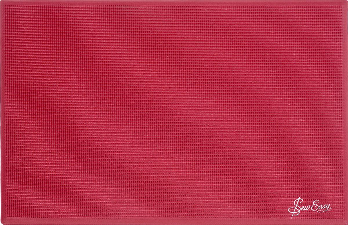 Мат для швейной машины Hemline, цвет: красный, 60,5 х 40 х 0,3 смER905.REDМат Hemline обеспечивает заботу о вашей рабочей поверхности. Изделие мягко пружинит и имеет толстую основу. Структура вафли минимизирует скольжение. Большое рабочее пространство позволяет равномерно распределять вес швейной машины. Мат минимизирует вибрацию. Закругленные края мата обеспечивают комфортную работу. Также мат дает удобное рабочее пространство для рук во время шитья.