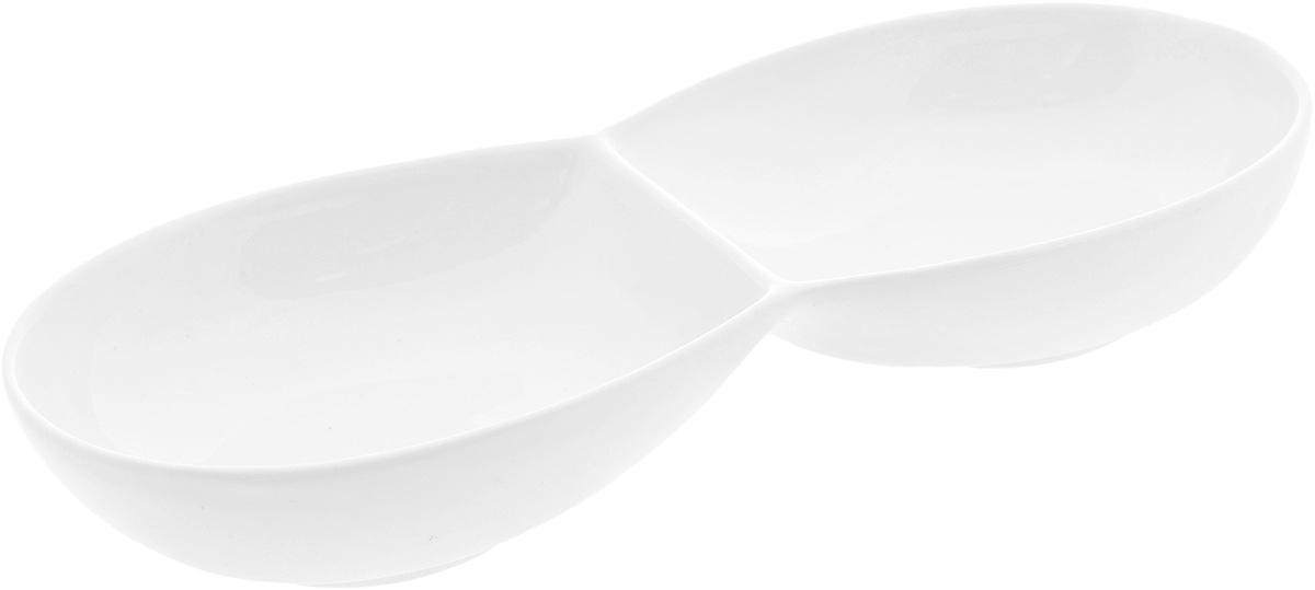 Менажница Wilmax, 2 секции. WL-992487WL-992487 / AМенажница Wilmax, изготовленная из высококачественного фарфора, состоит из 2 секций, выполненных в виде блюд. Изделие предназначено для подачи сразу нескольких видов закусок, нарезок, соусов и варенья. Оригинальная менажница Wilmax станет настоящим украшением праздничного стола и подчеркнет ваш изысканный вкус. Размер менажницы: 22,5 х 9,8 х 3,5 см. Размер секций: 11,5 х 9,8 см.