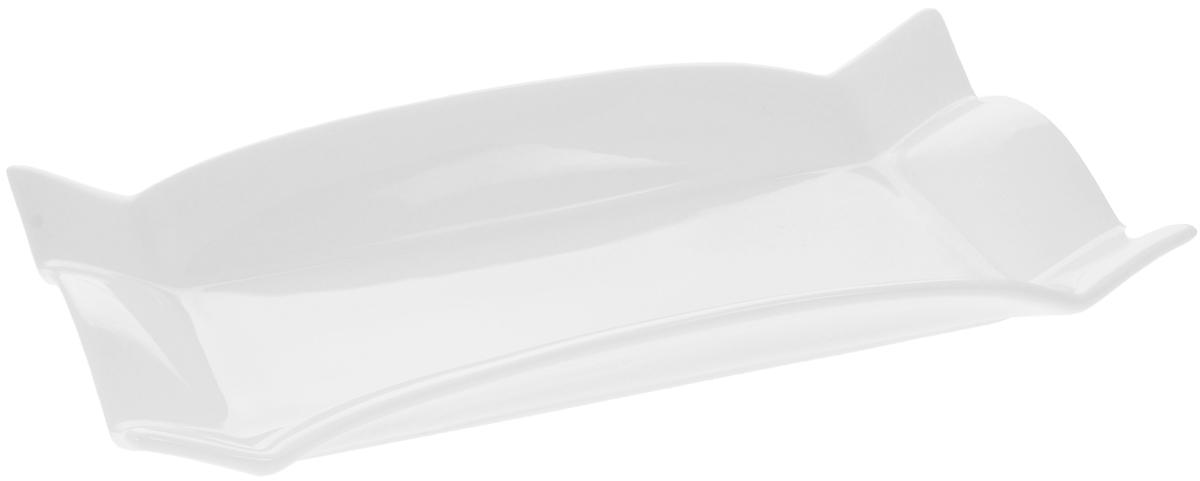 Блюдо Wilmax, 24,5 х 12,5 смWL-992582 / AОригинальное блюдо Wilmax, изготовленное из фарфора с глазурованным покрытием, прекрасно подойдет для подачи нарезок, закусок и других блюд. Оно украсит ваш кухонный стол, а также станет замечательным подарком к любому празднику. Можно мыть в посудомоечной машине и использовать в микроволновой печи. Размер блюда (по верхнему краю): 24,5 х 12,5 см. Высота блюда: 3.5 см.