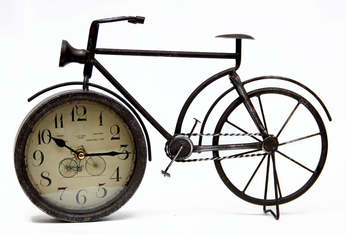 Часы настольные Magic Home Велосипед, кварцевые, цвет: черный41490Настольные кварцевые часы Magic Home Велосипед изготовлены из металла черного цвета, циферблат из черного металла с покрытием из принтованной бумаги. Настольные часы Magic Home Велосипед прекрасно оформят интерьер дома или рабочий стол в офисе. Часы работают от одной батарейки типа АА мощностью 1,5V (не входит в комплект).