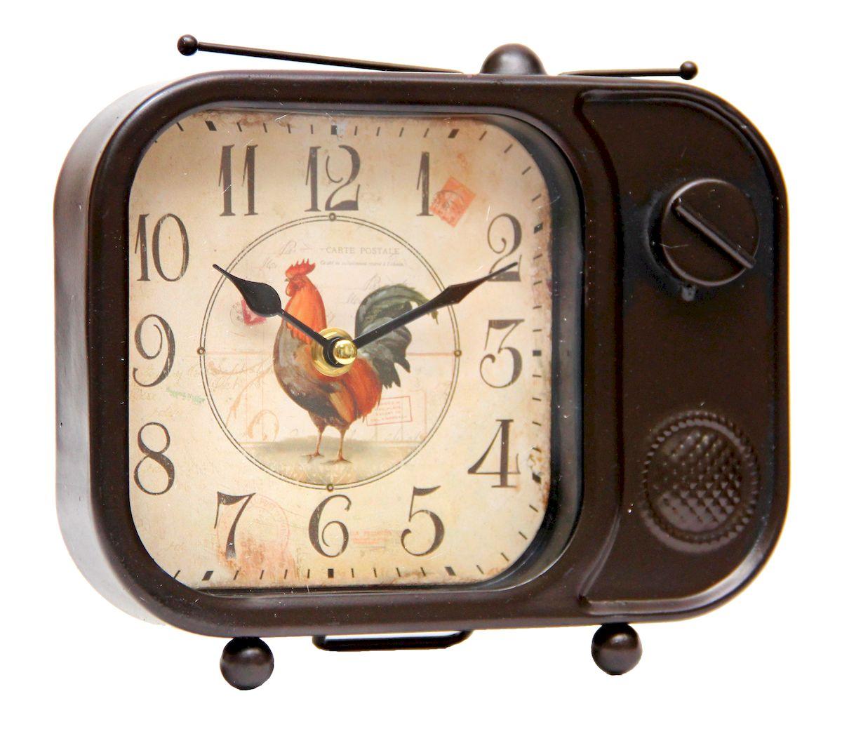 Часы настольные Magic Home Телевизор, кварцевые, цвет: коричневый41494Настольные кварцевые часы Magic Home Телевизор изготовлены из металла , циферблат из металла с покрытием из принтованной бумаги. Настольные часы Magic Home Телевизор прекрасно оформят интерьер дома или рабочий стол в офисе. Часы работают от одной батарейки типа АА мощностью 1,5V (не входит в комплект).