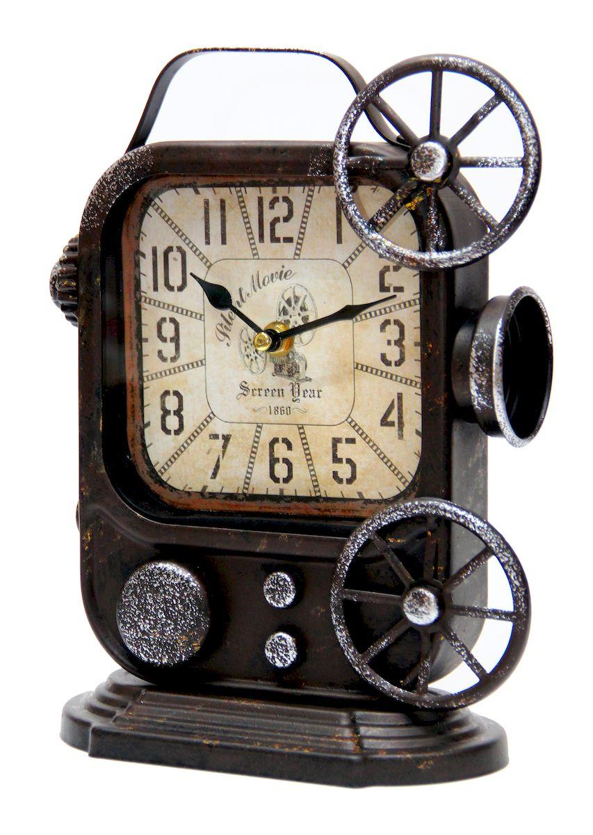 Часы настольные Magic Home Ретро Камера, кварцевые, цвет: черный41495Настольные кварцевые часы Magic Home Ретро Камера изготовлены из металла черного цвета, циферблат из черного металла с покрытием из принтованной бумаги. Настольные часы Magic Home Ретро Камера прекрасно оформят интерьер дома или рабочий стол в офисе. Часы работают от одной батарейки типа АА мощностью 1,5V (не входит в комплект).