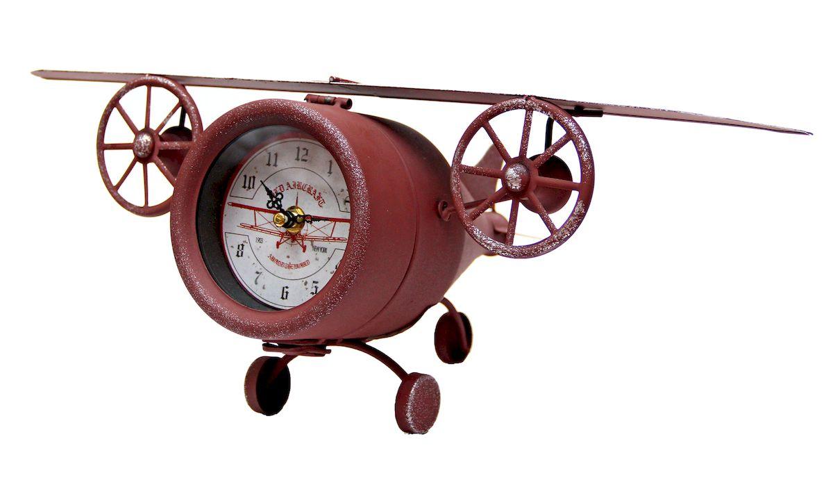 Часы настольные Magic Home Самолет, кварцевые, цвет: коричневый41497Настольные кварцевые часы Magic Home Самолет изготовлены из металла, циферблат с покрытием из принтованной бумаги. Настольные часы Magic Home Самолет прекрасно оформят интерьер дома или рабочий стол в офисе. Часы работают от одной батарейки типа АА мощностью 1,5V (не входит в комплект).