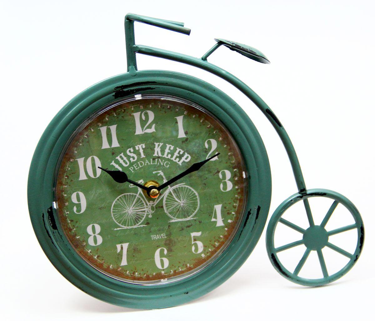 Часы настольные Magic Home Ретро Велосипед, кварцевые, цвет: зеленый41501Настольные кварцевые часы Magic Home Ретро Велосипед изготовлены из металла, циферблат с покрытием из принтованной бумаги. Настольные часы Magic Home Ретро Велосипед прекрасно оформят интерьер дома или рабочий стол в офисе. Часы работают от одной батарейки типа АА мощностью 1,5V (не входит в комплект).