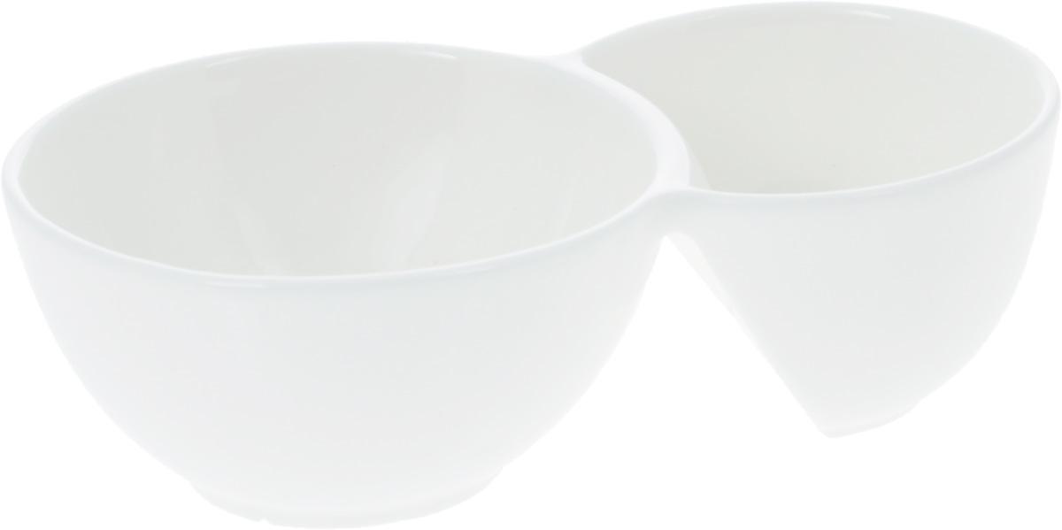 Емкость для закусок Wilmax, 18,5 х 11 смWL-992570 / AЕмкость для закусок Wilmax, изготовленная из высококачественного фарфора, состоит из двух секций. Емкость идеально подходит для оформления закусок. Она придется по вкусу и ценителям классики, и тем, кто предпочитает утонченность и изящность. Диаметр секций: 9 см; 11 см. Общий размер: 18,5 х 11 см.