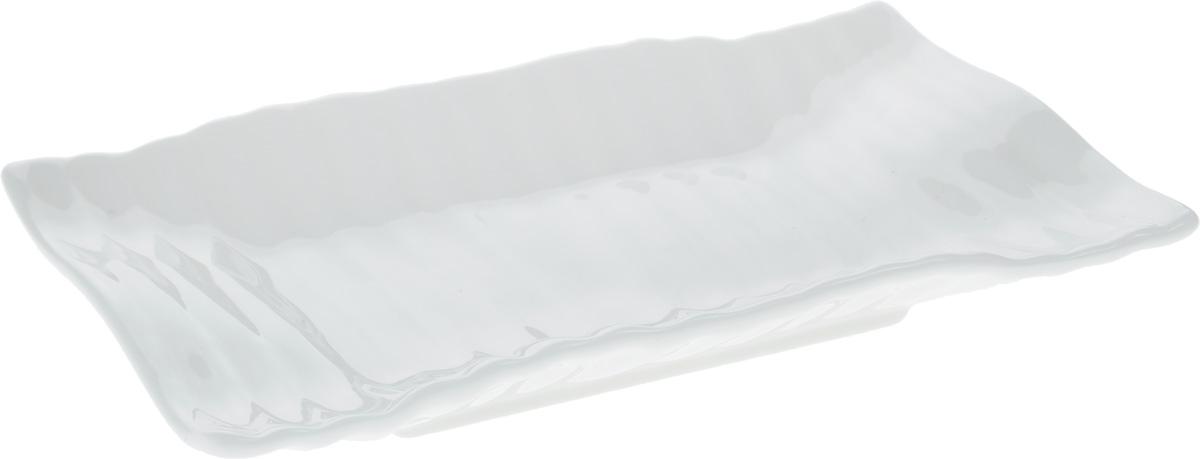 Блюдо Wilmax Японский стиль, 17,5 х 11,5 смWL-992625 / AОригинальное прямоугольное блюдо Wilmax Японский стиль, изготовленное из фарфора с глазурованным покрытием, прекрасно подойдет для подачи нарезок, закусок и других блюд. Фарфор от Wilmax изготовлен по уникальному рецепту из сплава магния и алюминия, благодаря чему посуда обладает характерной белизной, прочностью и устойчивостью к сколами. Особый состав глазури обеспечивает гладкость и блеск поверхности изделия. Оно украсит ваш кухонный стол, а также станет замечательным подарком к любому празднику. Можно мыть в посудомоечной машине и использовать в микроволновой печи. Изделие пригодно для использования в духовых печах и выдерживает температуру до 300°С.