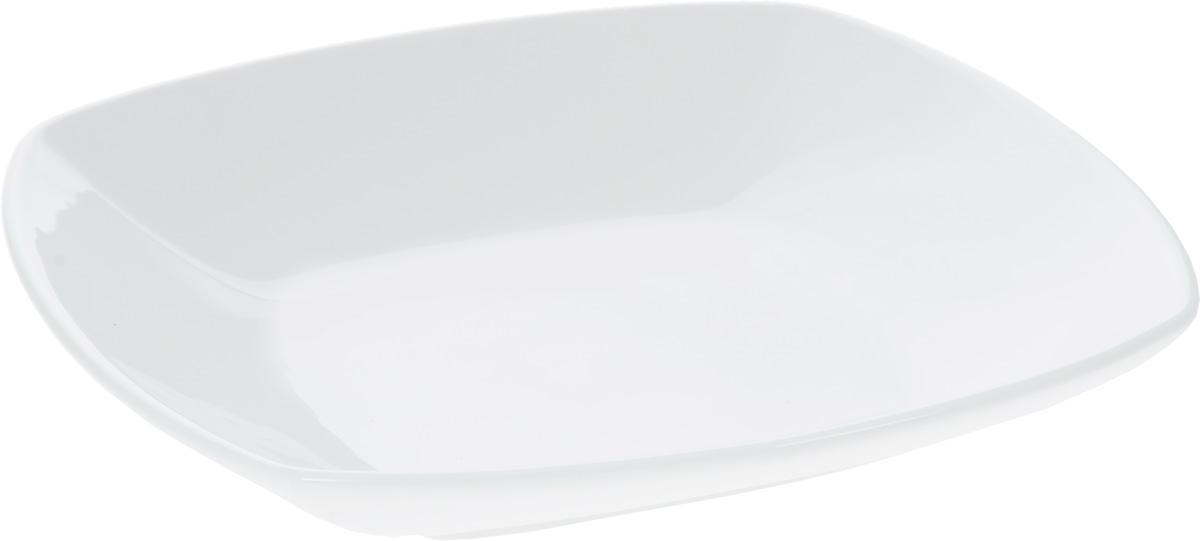 Тарелка глубокая Wilmax, 22 х 22 смWL-991213 / AКвадратная глубокая тарелка Wilmax изготовлена из фарфора с глазурованным покрытием. Фарфор от Wilmax изготовлен по уникальному рецепту из сплава магния и алюминия, благодаря чему посуда обладает характерной белизной, прочностью и устойчивостью к сколами. Особый состав глазури обеспечивает гладкость и блеск поверхности изделия. Изделие сочетает в себе изысканный дизайн с максимальной функциональностью. Тарелка прекрасно впишется в интерьер вашей кухни и станет достойным дополнением к кухонному инвентарю. Можно мыть в посудомоечной машине и использовать в микроволновой печи. Изделие пригодно для использования в духовых печах и выдерживает температуру до 300°С.