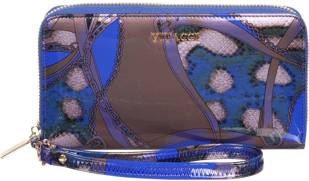 Кошелек женский Vitacci, цвет: синий. HS024HS024Модный женский кошелек Vitacci выполнен из натуральной лаковой кожи со змеиным принтом. Модель закрывается на застежку-молнию. Внутри 3 отделения для купюр, 2 потайных кармана, отделение для мелочи на застежке-молнии и 12 карманов для визиток и кредитных карт. Изделие дополнено съемным кожаным ремешком с замком-карабином. Такой кошелек станет прекрасным стильным подарком для любителей респектабельных аксессуаров и порадует простотой и функциональностью. Изделие упаковано в фирменную коробку.