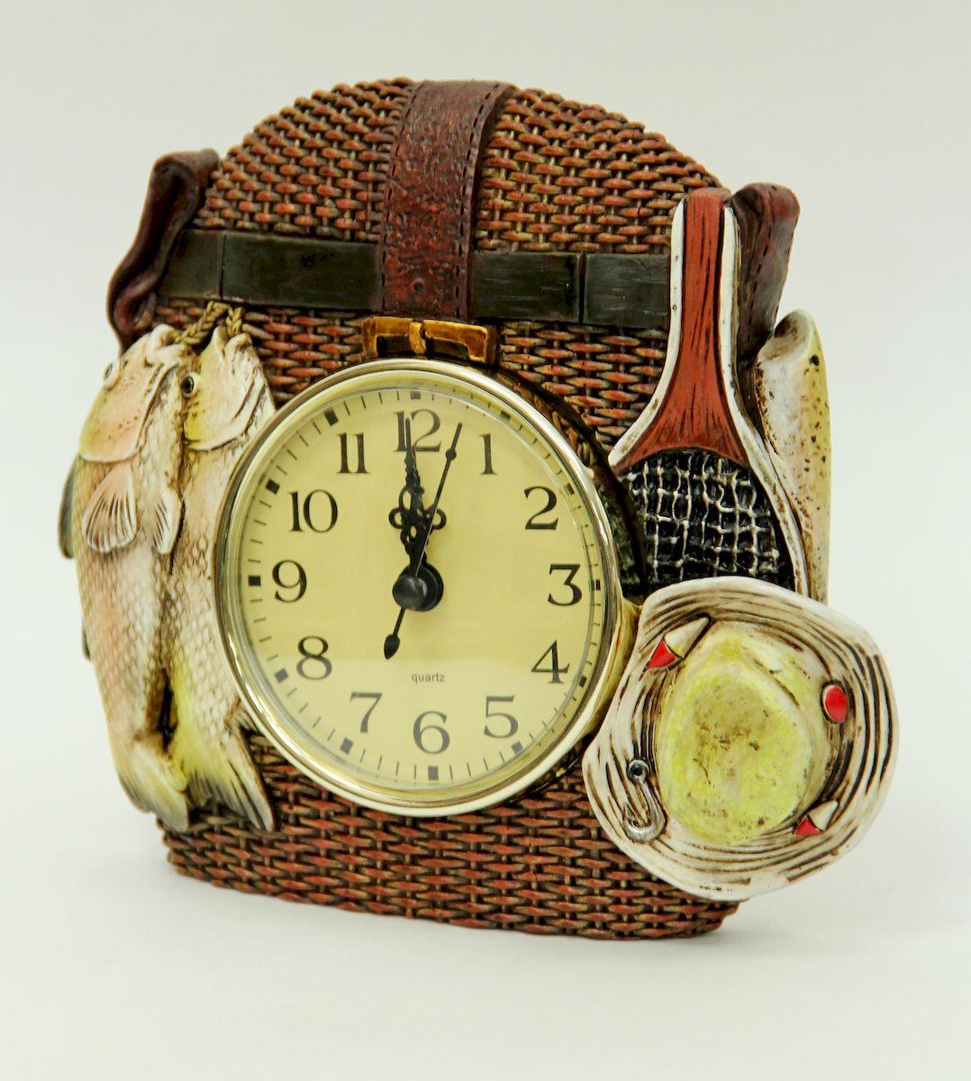 Часы настольные Magic Home Рыбалка. 4106041060Настольные кварцевые часы Magic Home Рыбалка изготовлены из полирезина, циферблат изготовлен из прочного пластика. Настольные часы Magic Home Рыбалка прекрасно оформят интерьер дома или рабочий стол в офисе. Элемент питания не входит в комплект.