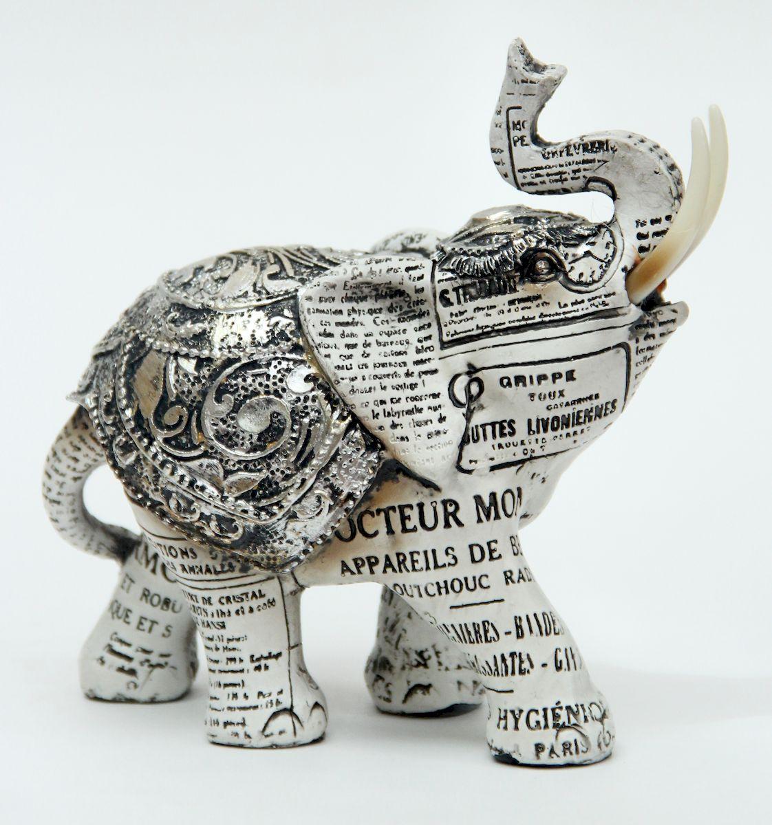 Фигурка декоративная Magic Home Слон. 4138541385Декоративная фигурка, изготовленная из полирезина, оформлена под папье-маше из газетных вырезок. Оригинальная фигурка прекрасно дополнит любой интерьер.