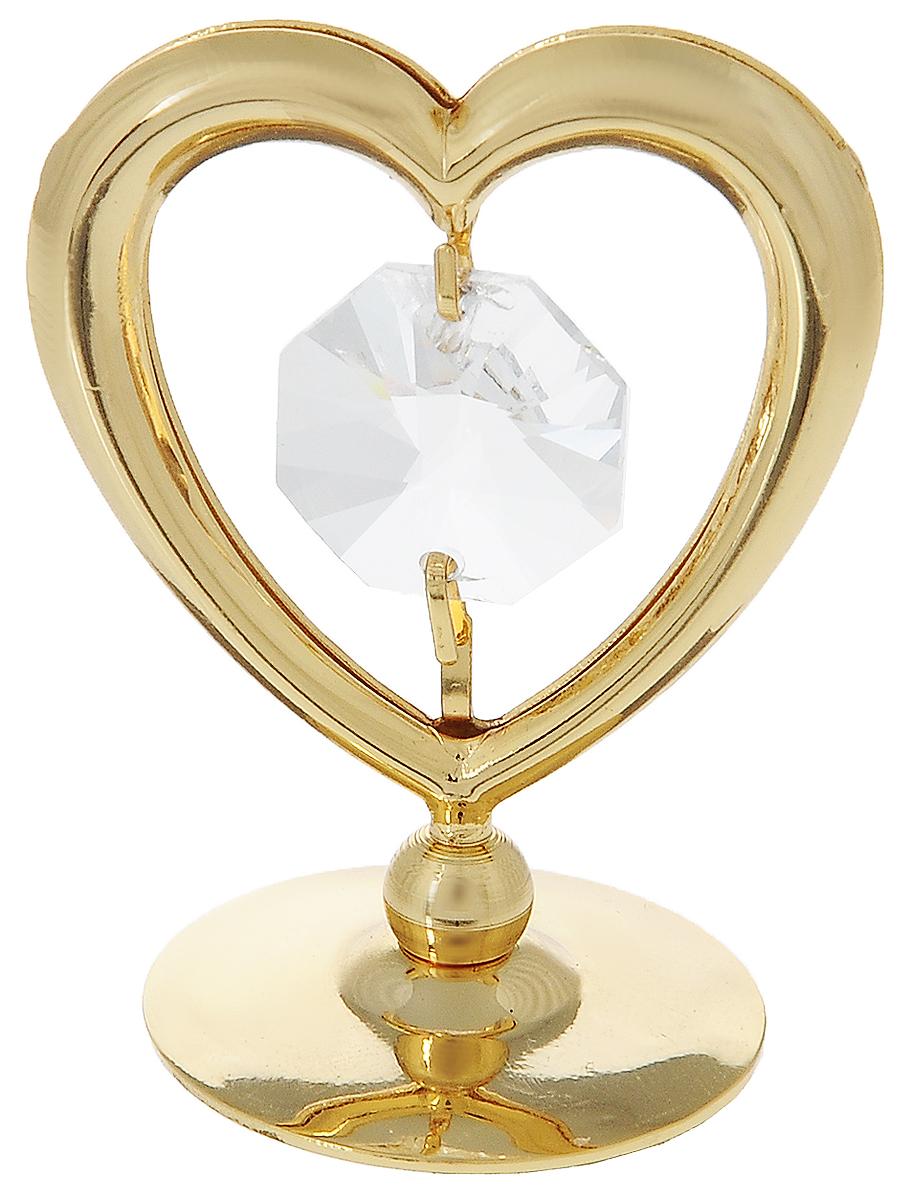 Миниатюра Crystocraft СердцеU0252-081-GC1_вид 2Миниатюра Crystocraft Сердце станет необычным аксессуаром для вашего интерьера и создаст незабываемую атмосферу. Изделие выполнено из высококачественной нержавеющей стали с золотистым покрытием и украшено кристаллом Swarovski. Ограненный кристалл, точно бриллиант, блистает сотнями различных оттенков. Эта очаровательная вещь послужит отличным подарком близкому человеку, родственнику или другу, а также подарит приятные мгновения и окунет вас в лучшие воспоминания.