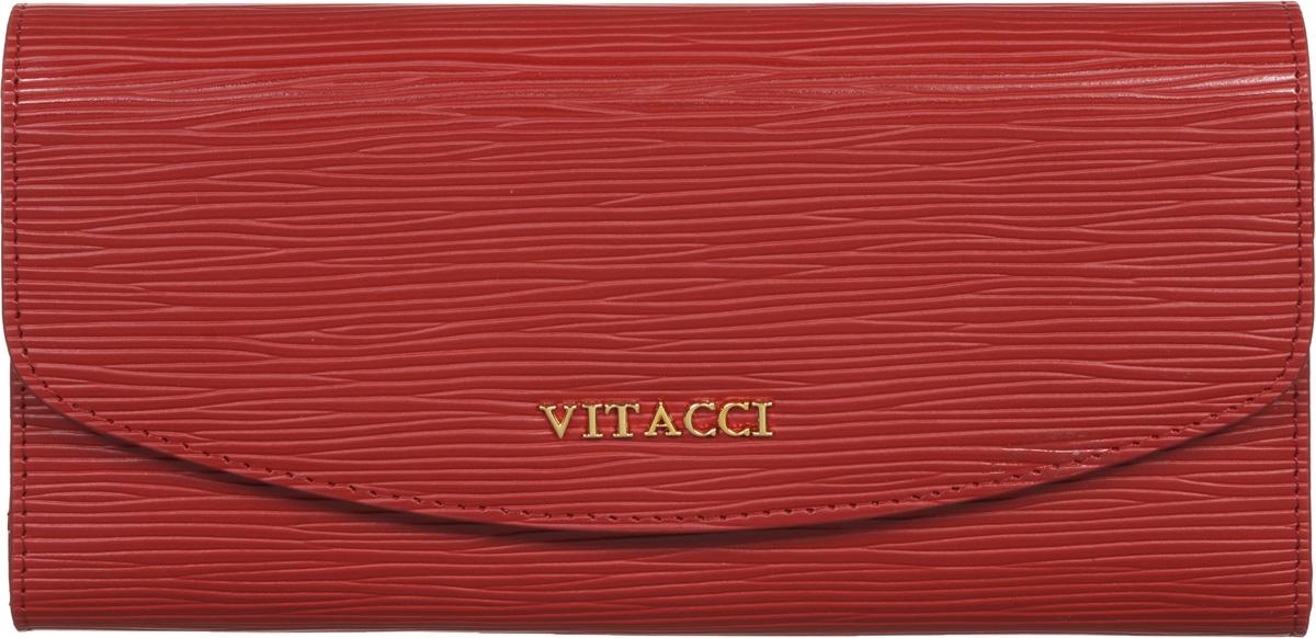 Кошелек женский Vitacci, цвет: красный. HS013HS013Кошелек Vitacci выполнен из высококачественной натуральной кожи с ребристой фактурой. Кошелек закрывается на клапан с кнопкой. Внутри кошелька имеется отделение для мелочи на молнии, два отделения для купюр, три горизонтальных открытых кармана, тринадцать отделений под визитки или карточки. Классический дизайн и стильный декор в сочетании с удобством и вместительностью делают этот аксессуар незаменимым.