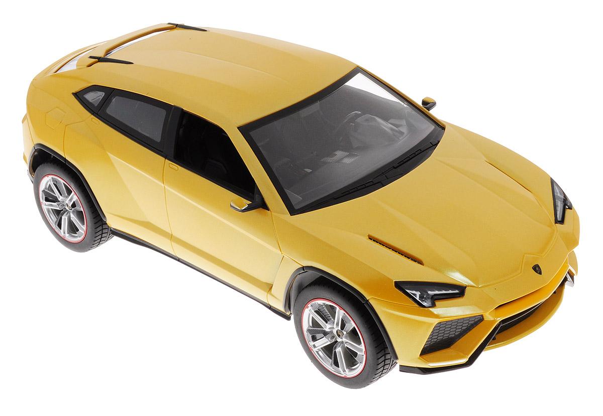 Rastar Радиоуправляемая модель Lamborghini Urus цвет желтый73000_желтыйРадиоуправляемая модель Rastar Lamborghini Urus очень детально воспроизводит реальный автомобиль. Такая модель автомобиля станет отличным подарком не только автолюбителю, но и человеку, ценящему оригинальность и изысканность, а качество исполнения представит такой подарок в самом лучшем свете. Модель выполнена из пластика с металлическими элементами и оснащена световыми эффектами. Маневренная и реалистичная уменьшенная копия выполнена в точной детализации с настоящим автомобилем в масштабе 1:14. На пульте расположены 4 кнопки (вперед - назад, вправо - влево). Пульт управления с удобными держателями позволит ребенку играть с машинкой хоть сидя, хоть стоя. Радиоуправляемые игрушки способствуют развитию координации движений, моторики и ловкости. Машина работает от 5 батареек типа АА (не входят в комплект). Пульт управления работает от батарейки 9V типа Крона (не входит в комплект).
