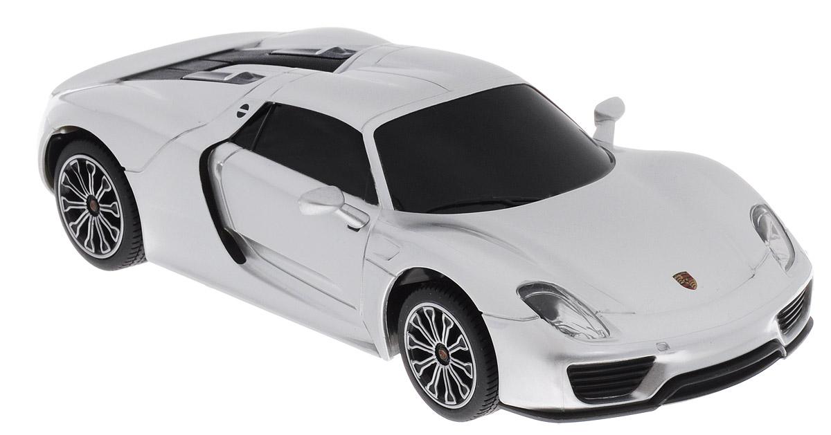 Rastar Радиоуправляемая модель Porsche 918 Spyder цвет серебристый71400Радиоуправляемая модель Rastar Porsche 918 Spyder является точной копией настоящего автомобиля в масштабе 1/24. Управление автомобилем происходит с помощью удобного пульта. Машина двигается вперед и назад, поворачивает направо и налево. Колеса игрушки прорезинены и обеспечивают плавный ход, машинка не портит напольное покрытие. Пульт управления работает на частоте 27 MHz. Такая модель автомобиля станет отличным подарком не только автолюбителю, но и человеку, ценящему оригинальность и изысканность, а качество исполнения представит такой подарок в самом лучшем свете. Радиоуправляемые игрушки способствуют развитию координации движений, моторики и ловкости. Машина работает от 3 батареек типа АА (не входят в комплект). Пульт управления работает от 2 батареек типа АА (не входят в комплект).