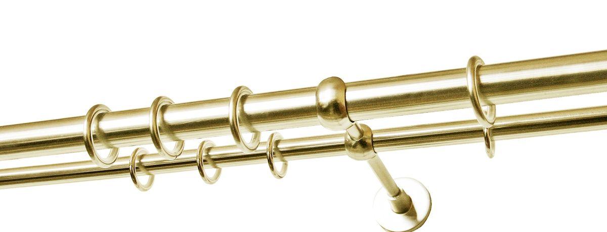 Карниз двухрядный Уют Ост, металлический, цвет: латунь, диаметр 25 мм, длина 1,4 м26.02ТО.650К.140Двухрядный круглый карниз Уют Ост выполнен из цинко- алюминиевого сплава с гальваническим покрытием. Подходит для использования двух видов занавесей. Поверхность гладкая. Способ крепления настенное. В комплект входят 2 штанги, 2 кронштейна с крепежом и 28 колец с крючками. Наконечники приобретаются дополнительно. Такой карниз будет органично смотреться в любом интерьере. Диаметр карниза: 25 мм.