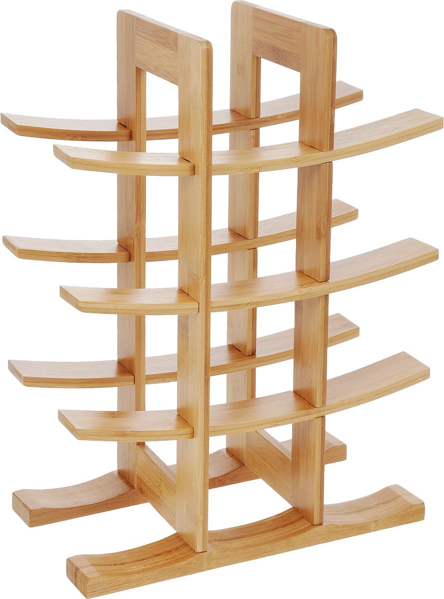 Подставка для бутылок Zeller, 29 х 16 х 42 см13580Подставка для бутылок Zeller, изготовленная из бамбукового дерева, предназначена для размещения шести винных или пивных бутылок. Устойчивая форма, удобство, надежная конструкция делают эту подставку незаменимой для хранения бутылок. Данное изделие идеально впишется в интерьер любой кухни и будет служить элементом декора. Подставка поставляется в разобранном виде. Изделие состоит из 10 элементов, в комплект входят 4 самореза и инструкция по сборке. Размер подставки: 29 х 16 х 42 см. Количество отделений для бутылок: 6.
