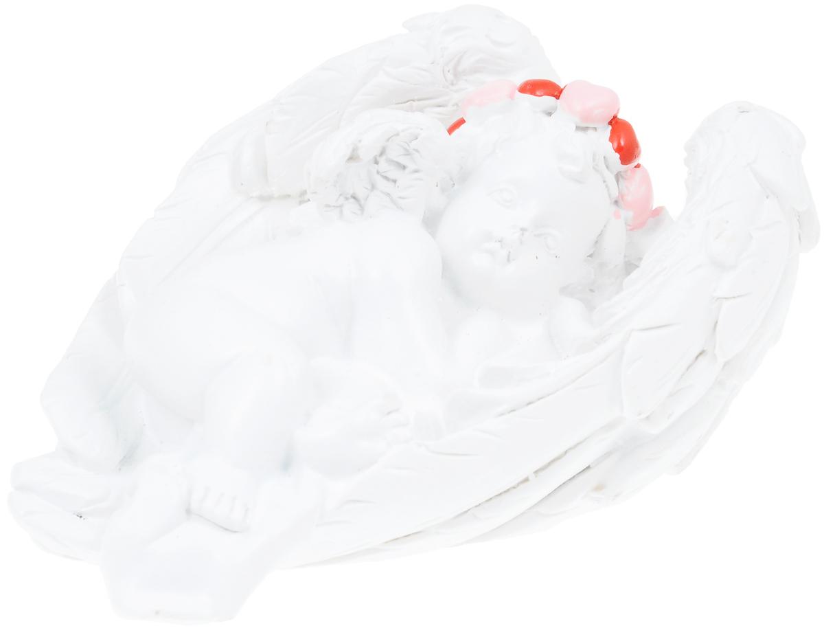 Фигурка декоративная Феникс-Презент Ангел на крыльях счастья, высота 3,5 см40167Фигурка декоративная Феникс-Презент Ангел на крыльях счастья, выполненная из полирезины, станет оригинальным подарком для всех любителей необычных вещей. Она выполнена в классическом стиле в виде ангела в венке, лежащего на крыльях. Изысканный сувенир станет прекрасным дополнением к интерьеру. Вы можете поставить фигурку в любом месте, где она будет удачно смотреться и радовать глаз.